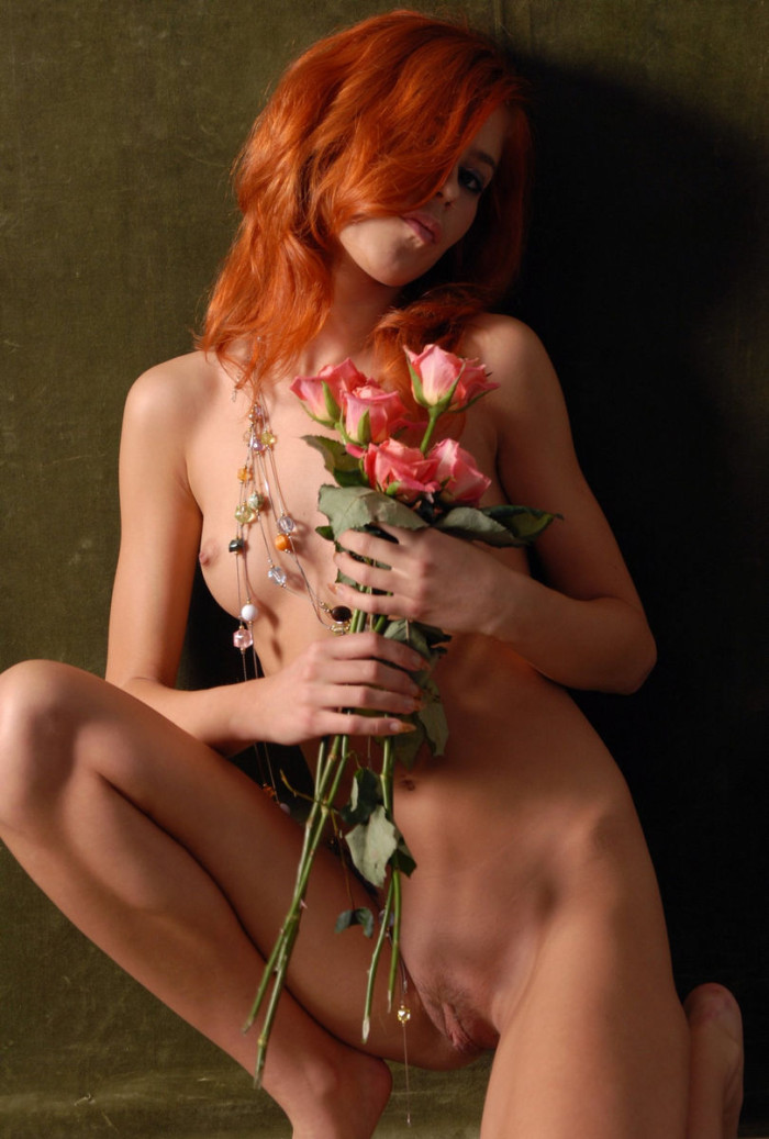 Beautiful Red-Haired Girl With Flowers Is Photographed -3815