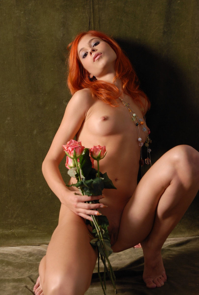Beautiful Red-Haired Girl With Flowers Is Photographed -2165