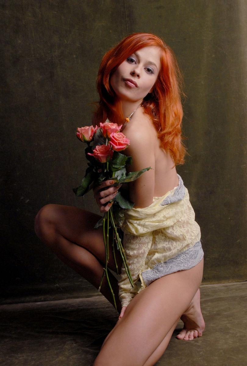 Beautiful Red-Haired Girl With Flowers Is Photographed -4395