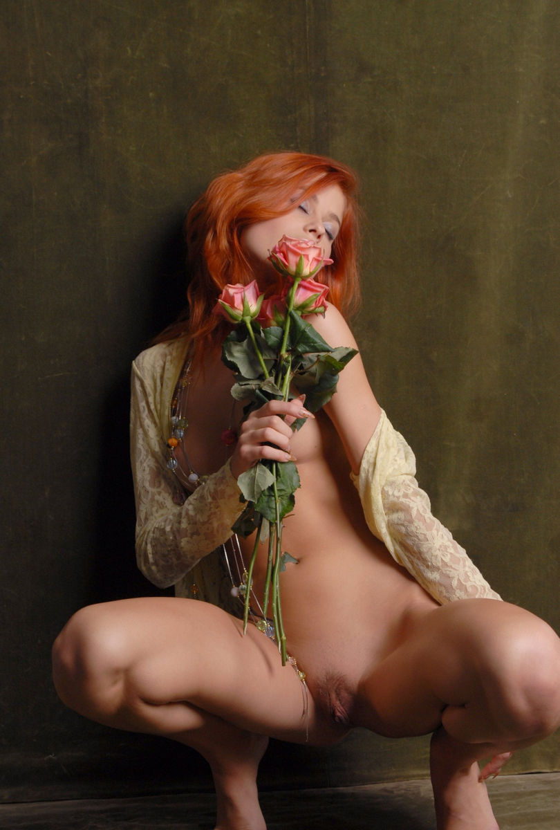 Beautiful Red-Haired Girl With Flowers Is Photographed -8537