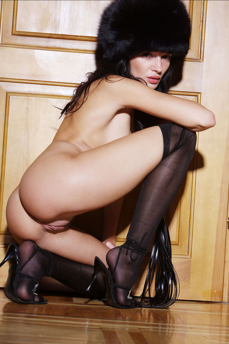 Hot Brunette In A Fur Hat And Stockings Shows Shaved Pussy -6982