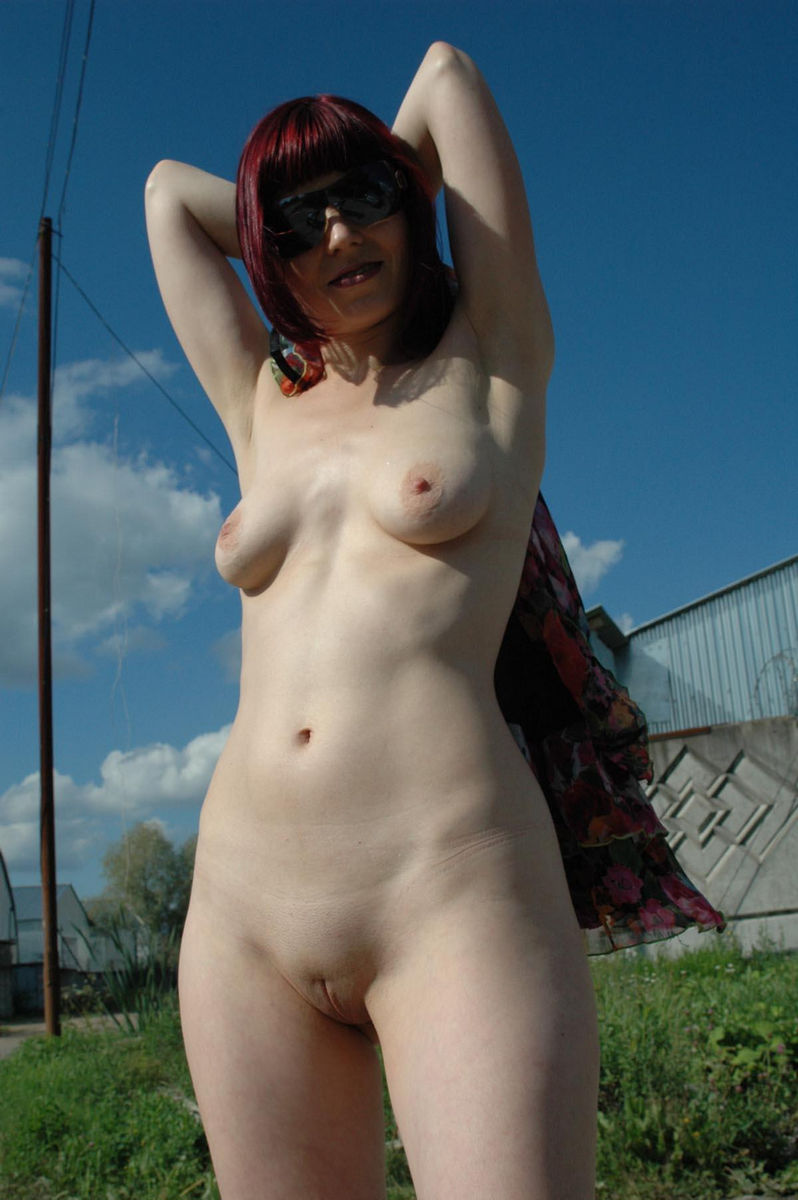 redhead russian in sunglasses walks naked outdoors