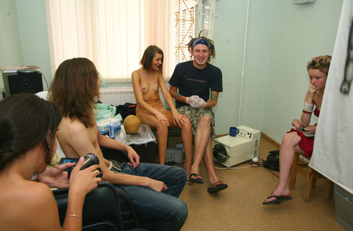 Shameless Russian Girl Is Undressing Behind Several Men -5623
