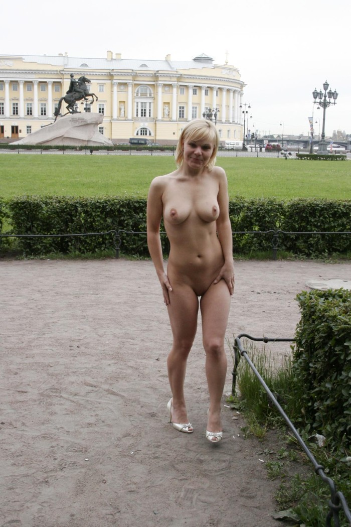 Busty blonde with short hair shows her shaved pussy very closely