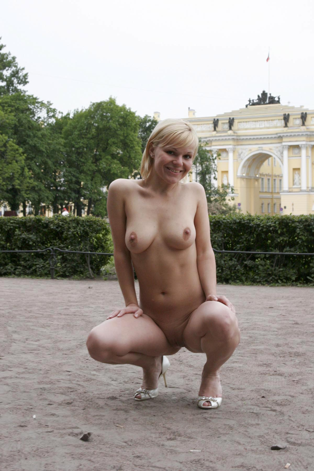Short-Haired Busty Blonde Walks Naked At Very Center Of -1085