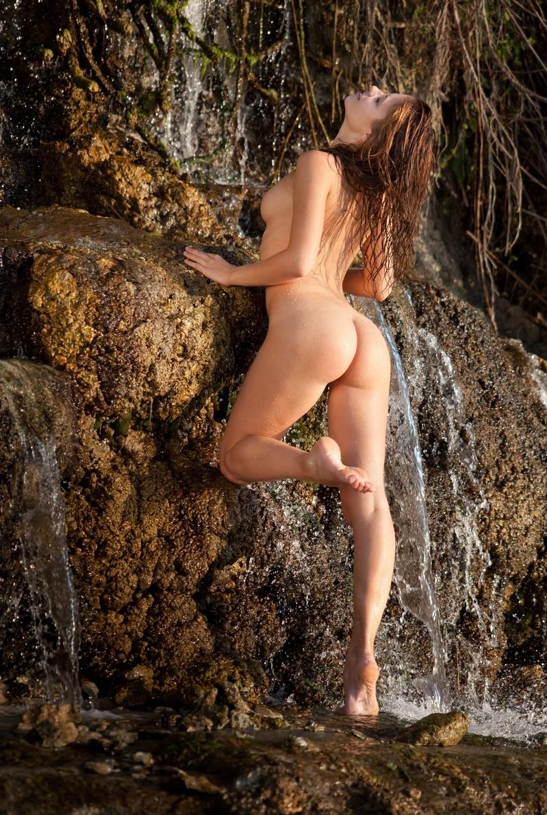nude girl on waterfall with boyfriend
