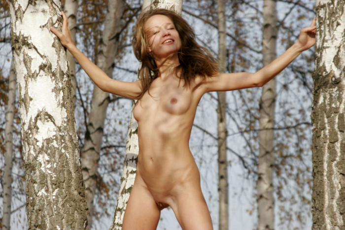 Russian short-haired blonde shows all her goods at forest