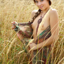 Skinny russian girl with small tits posing naked in the fields