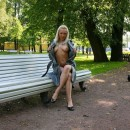 Smiling blonde takes off black panties and flashes body to fisherman