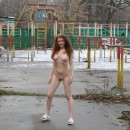 Very cute russian teen girl with tattoo walks naked at yard in Moscow