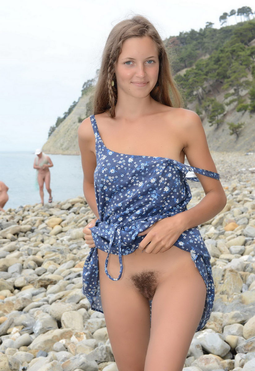 young girl with hairy pussy and a good figure posing on the beach