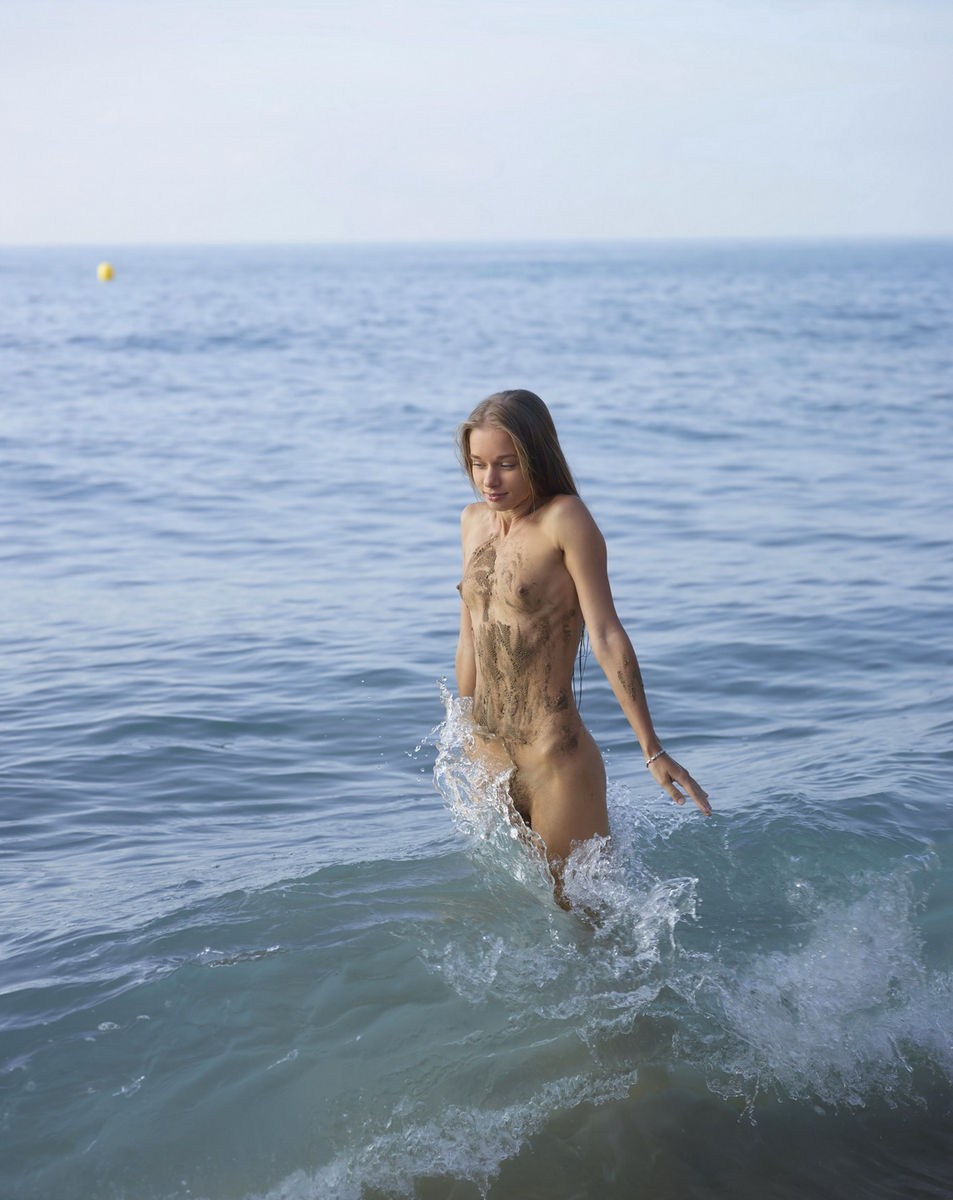 very skinny young naked girl on the beach