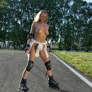 Russian blonde with perfect boobs on roller skates in very public place