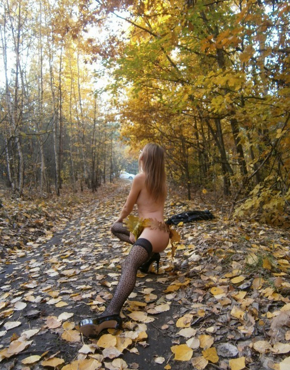 tall russian girl in sexy dress posing at forest russian