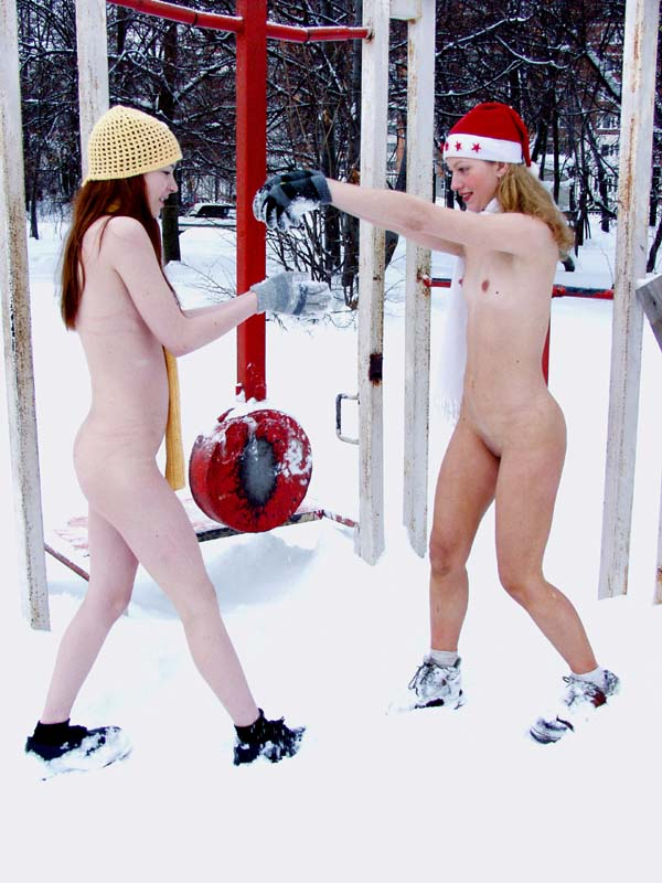 Two russian teens posing naked at winter yard