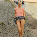 Blonde from St. Petersburg lifts up her skirt on the pier