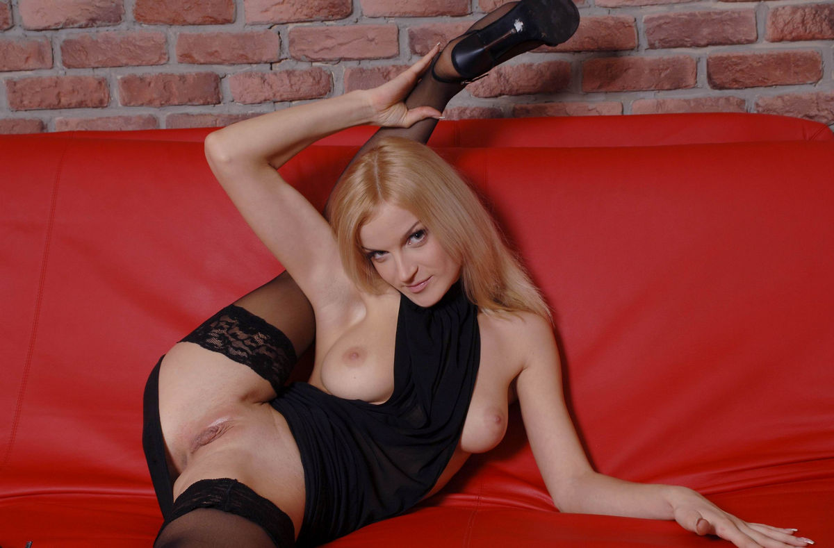busty blonde with very beautiful and big vagina on red sofa