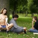 Lovely russian girl in very short skirt walks at public park