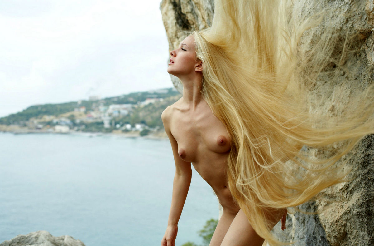 Naked Long-Haired Blonde Posing On The Rocks Near Sea -1928