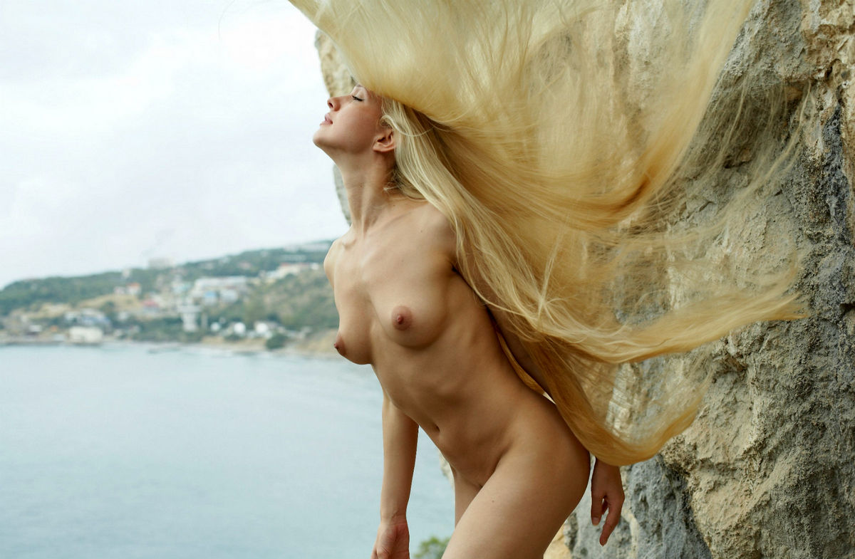 Naked Long-Haired Blonde Posing On The Rocks Near Sea -7368