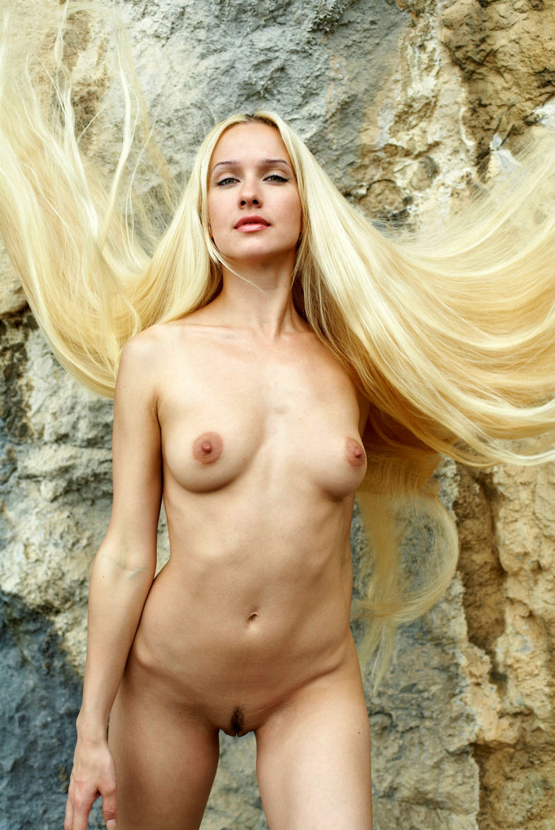 Naked Long-Haired Blonde Posing On The Rocks Near Sea -5611