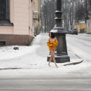 Russian brunette exhibitionist walks naked at public street at winter