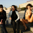 Russian girl posing naked on the pier with strangers