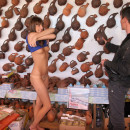 Russian girl undressing in front of the seller in the shop