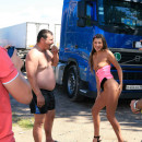 Shameless teen posing naked in front of truckers