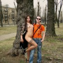 Smiling girl flashes her naked body at different public places