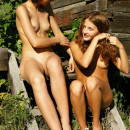 Two russian lesbians on the porch of a house in the village
