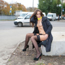 Very beautiful lady undressing in the park in front of students