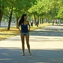 Completely naked brunette walks the streets in the midst of the day