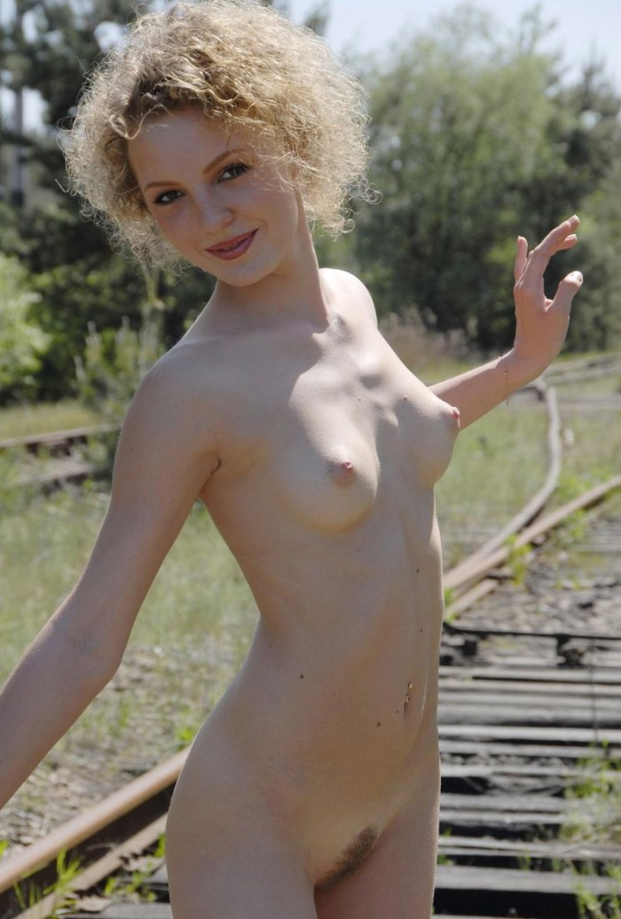 Thin girl with hairless pussy in the barn with hay