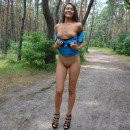 Girl walking in a dress without panties in the park
