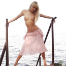 Skinny blonde with young body on small pier