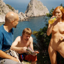Sporty redhead posing naked with climbers