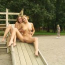 Two busty blondes posing absolutely naked at very public places