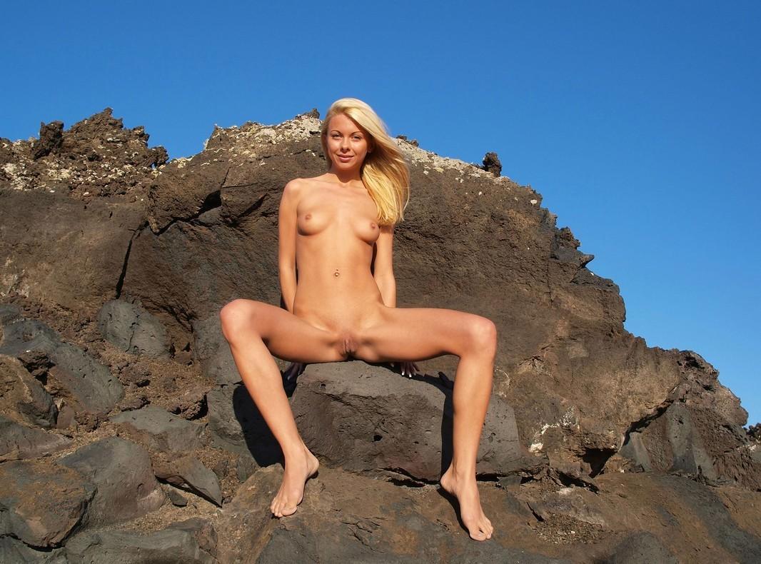 Athletic blonde with piercings on black rocks | Russian ...