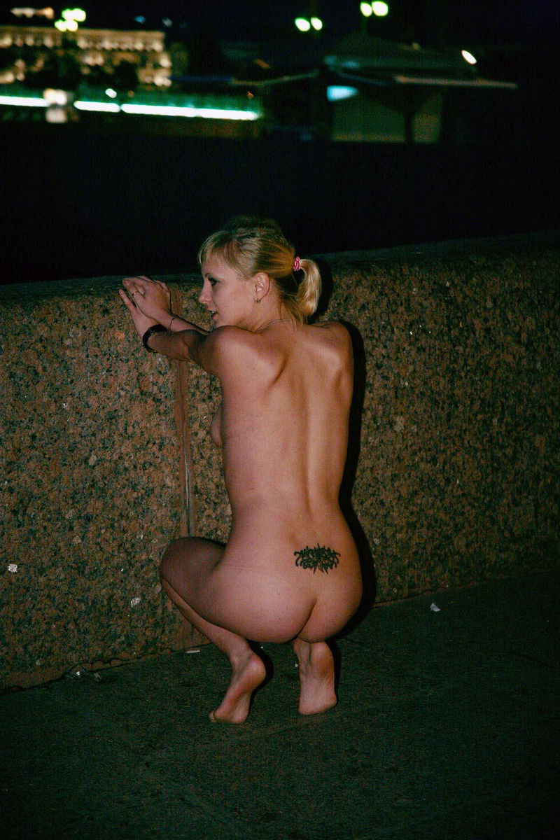 Blonde With A Tattoo On The Lower Back Walks Naked Through -7118