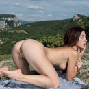 Busty brunette with big pussy in mountains