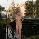 Naked blonde with tattoos walking in the morning the city