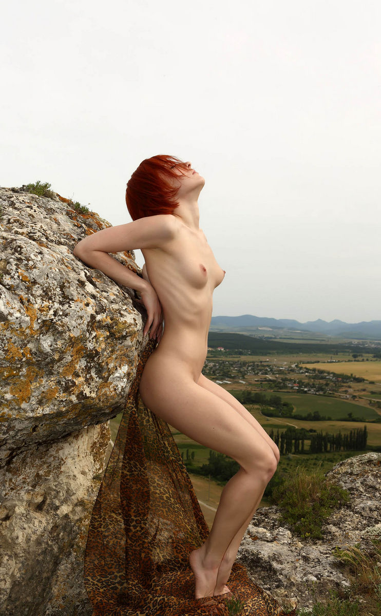 Naked Red Haired Woman On Top Of A Sheer Cliff S