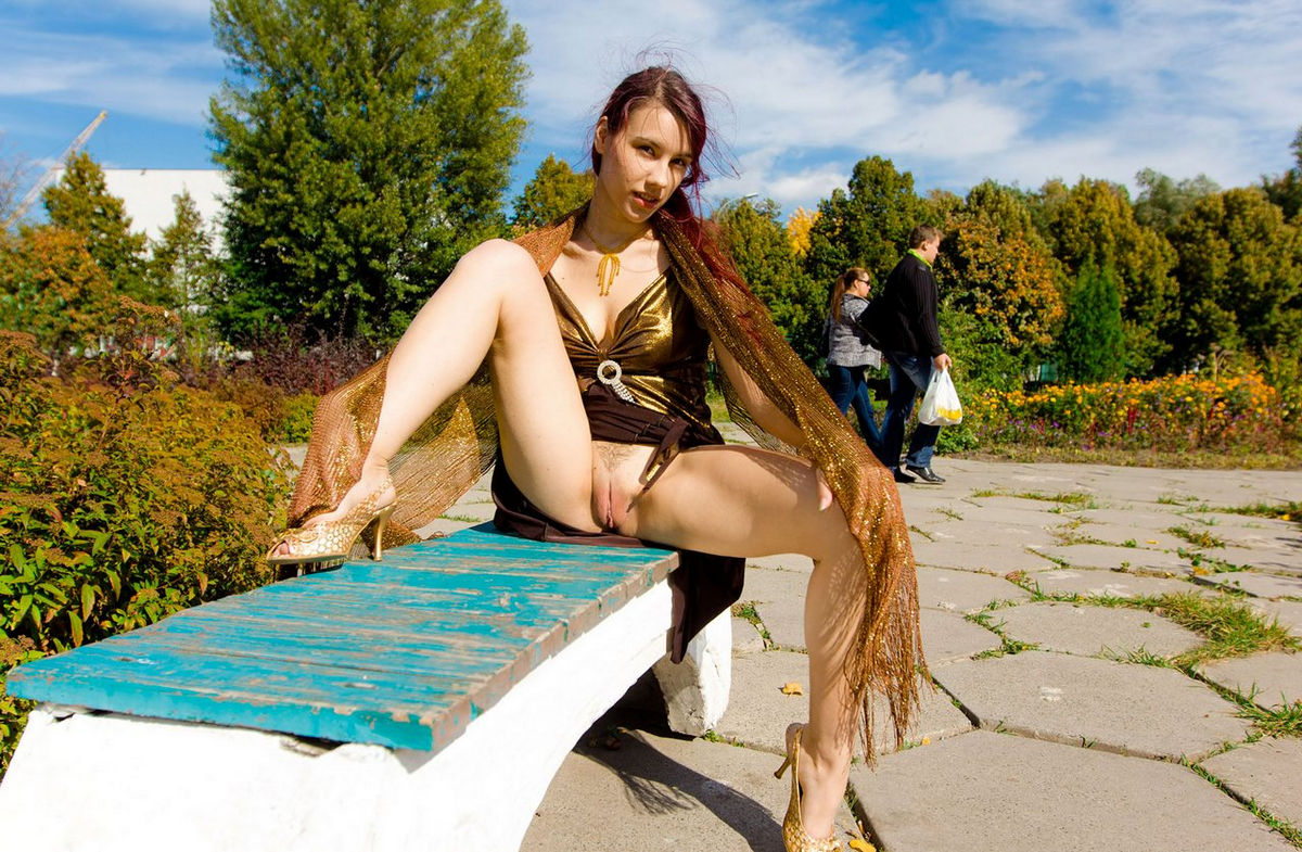 Red-haired babe in a gold dress shines hairy pussy in the ...
