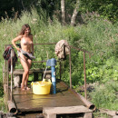 Russian beauty playing with water at public