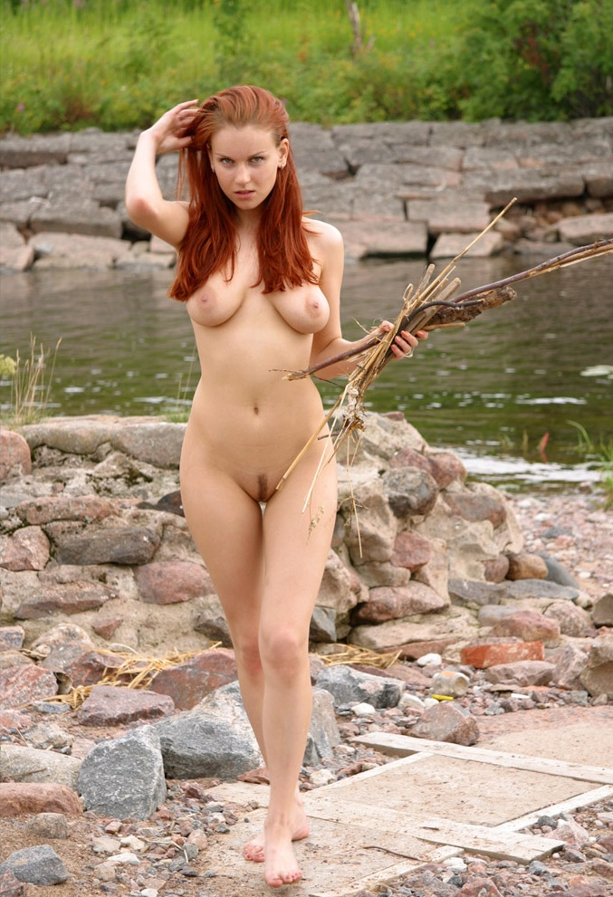 Magnificient woman with a slender figure and small tits in nature