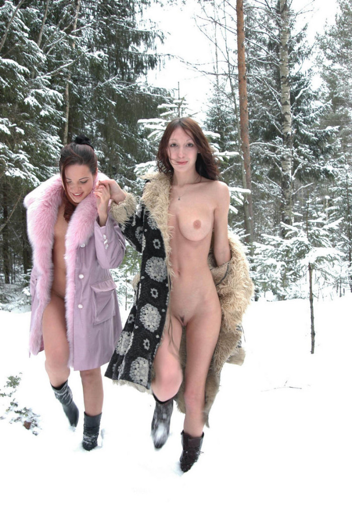 Two naughty Russian beauties having a picnic in winter forest
