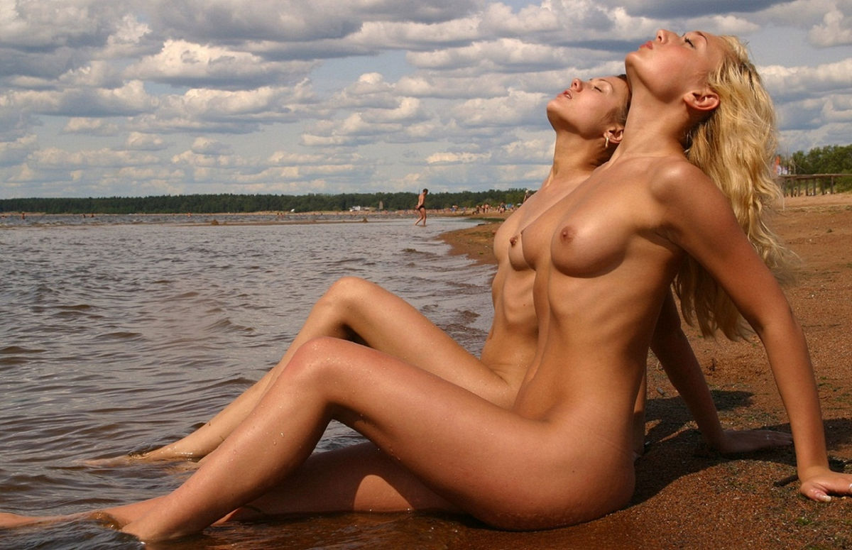 two young beauties fully naked on a public beach russian sexy girls