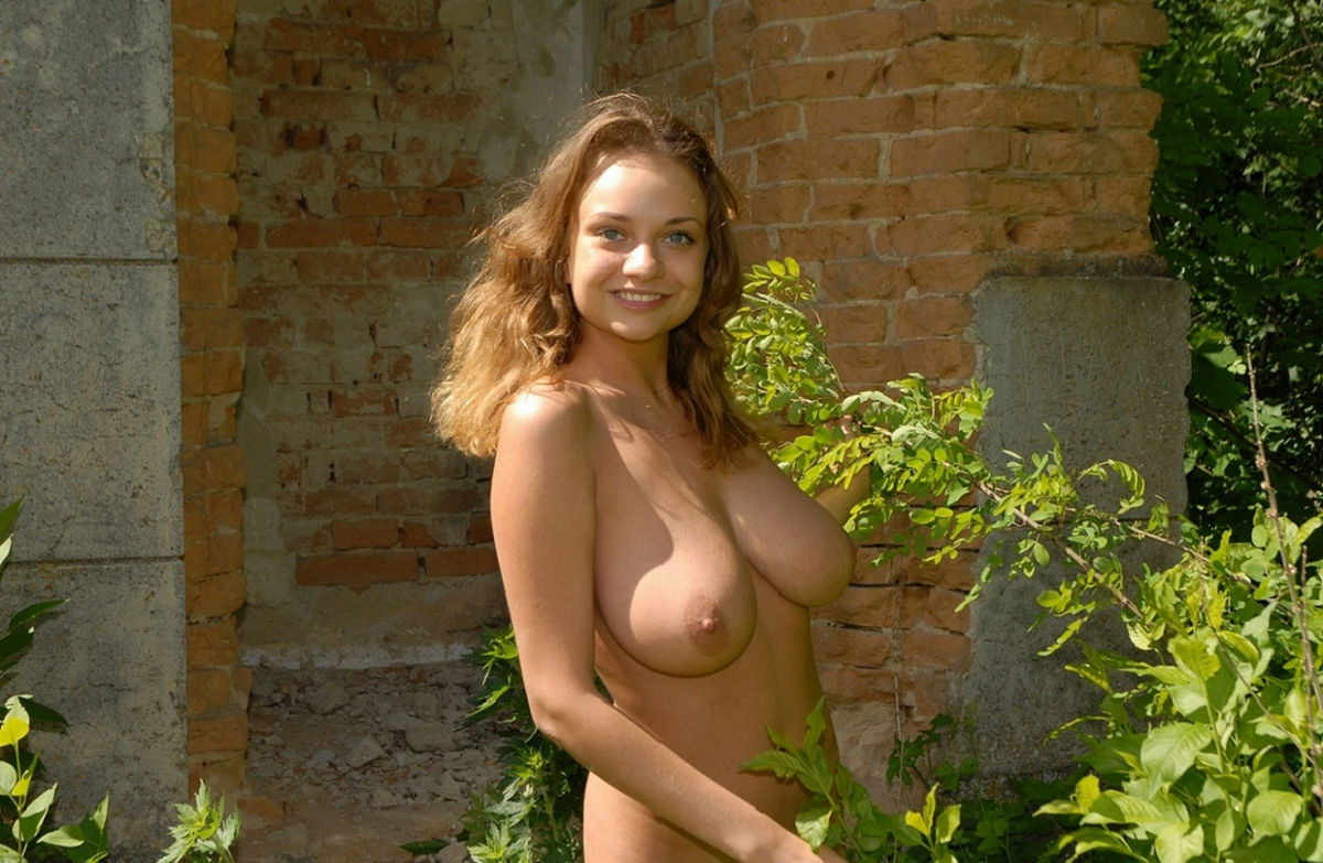 Russian girl with big tits undresses