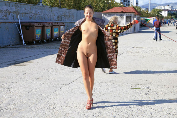 Girl with very small tits walks naked at public pier
